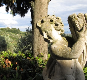 The cherub statue in the gardens at the Villa del Cielo with Caminetto