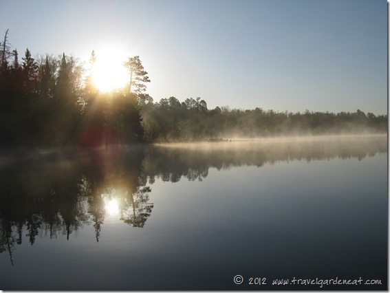 Mist rises at sunrise on one of Minnesota's many lakes