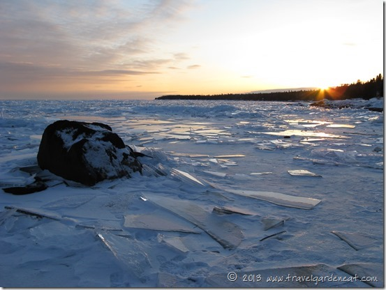The sun sets on the frozen North Shore of Lake Superior near Cascade River