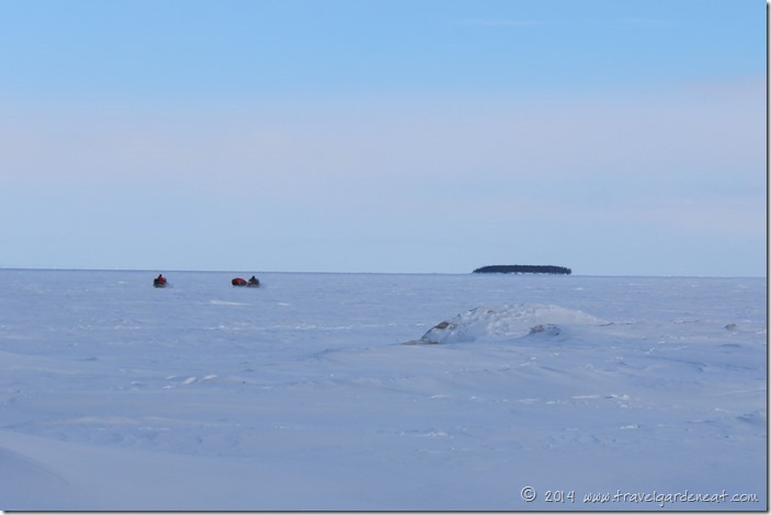 National Park Service snowmobiles heading across the ice