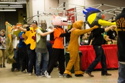 Mascot conga line in the pits