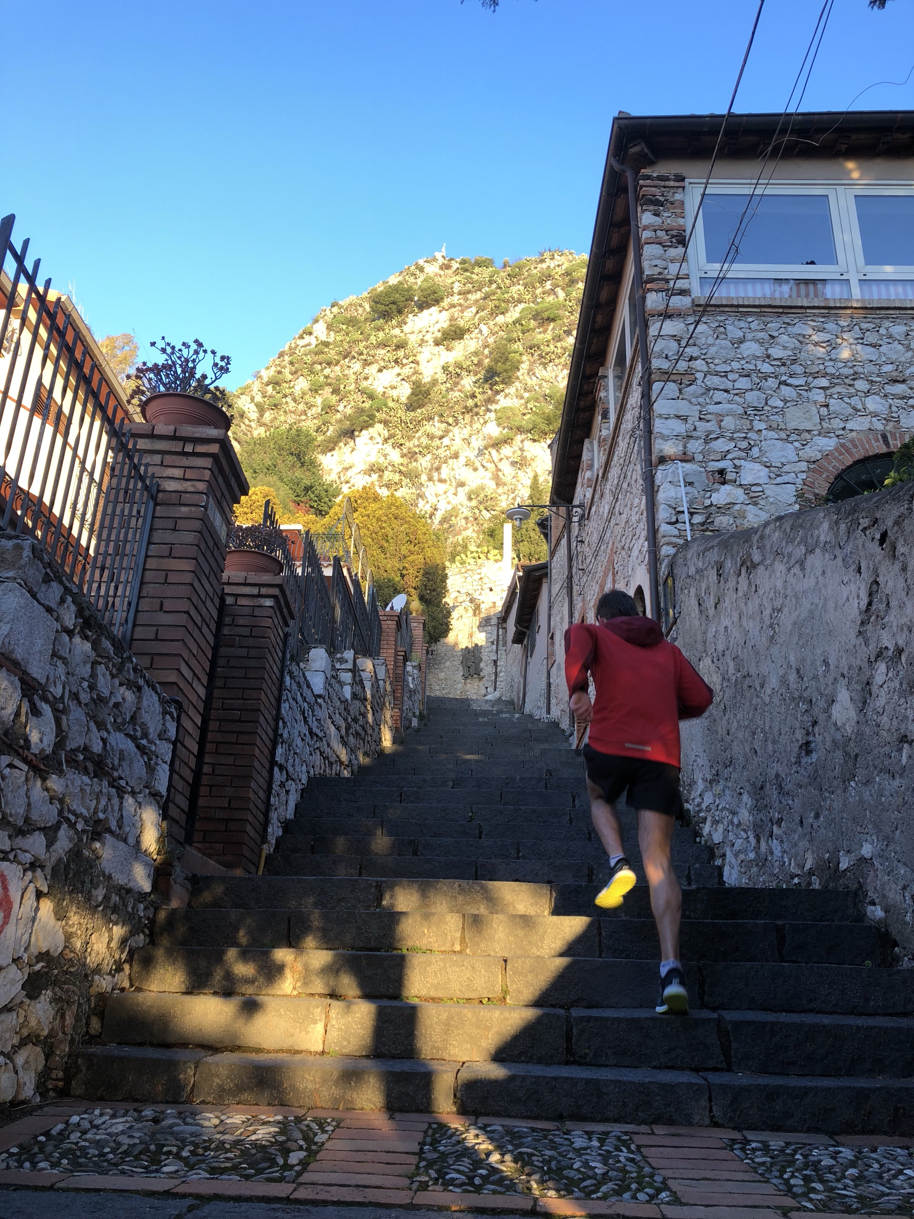 Climbing the stairs in Taormina